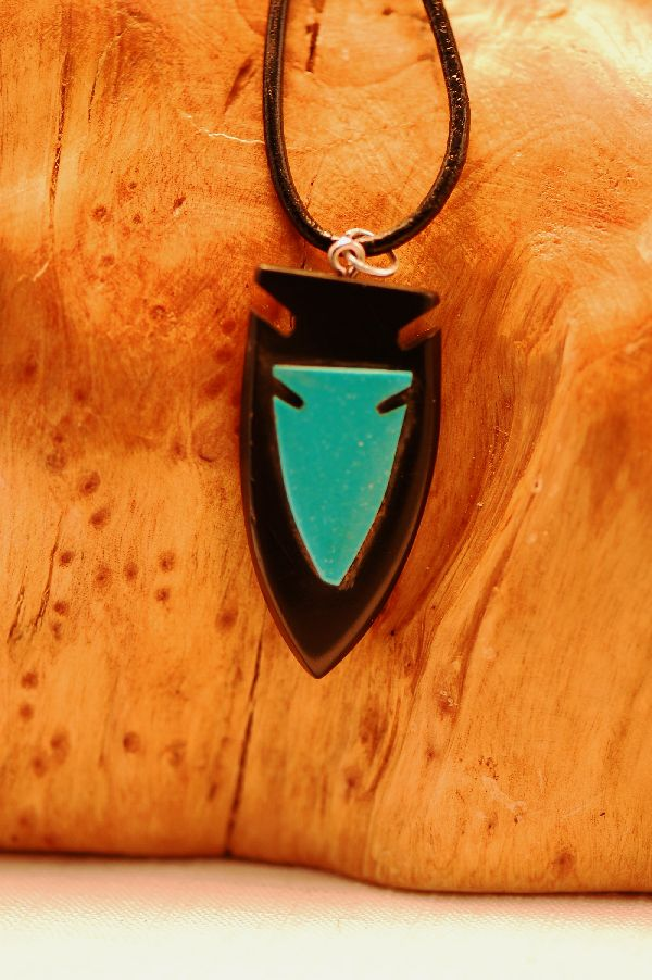 Carved Arrowhead Turquoise Pendant